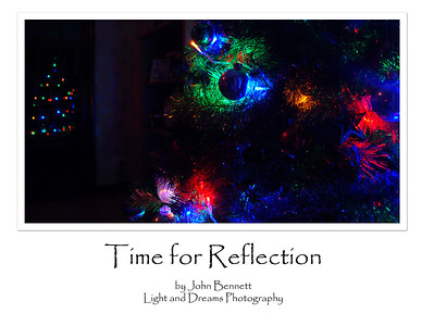 """01.01.13 - Time for Reflection?  This is an odd one, at the start of the new year we should be looking forward not back, so there is nothing profound about this, it is just a quirk of timing! I didn't take any photos worth sharing, but I did have a play with this shot of Christmas tree lights reflected in a glass door.  Thanks for your wonderful comments on my """"indoor fireworks"""" shot yesterday, I've had a lot of fun with the Christmas tree lights one way or another :)"""