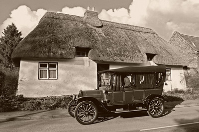 """04.03.14 - 1914  One of the reasons we chose the village of Thimbleby as the setting for """"Tell Them of Us"""" is the vernacular architecture known as """"mud and stud"""". It is a construction method unique to Lincolnshire, but only a small number of them survive. The Studebaker car dates from 1913, but the cottage behind is considerably older, built in the 17th century. The white line in the road and the new kerbstones are the only signs of the modern world in this image."""
