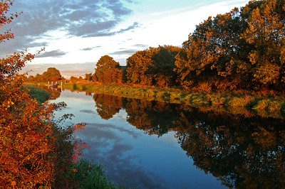 Golden hour reflections in the River Witham near Washingborough, Lincoln, UK