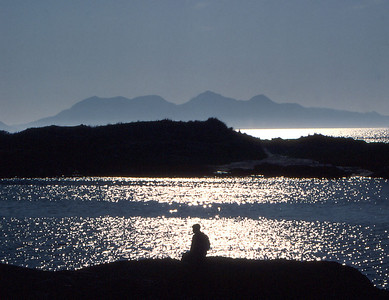 Lost in thought on the Scottish coast near Arisaig, with the island of Rum across the sparkling sea.